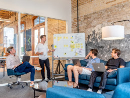 Four people strategizing | business development for recruitment