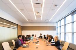 Team using AI technology on laptops | AI-recruitment software